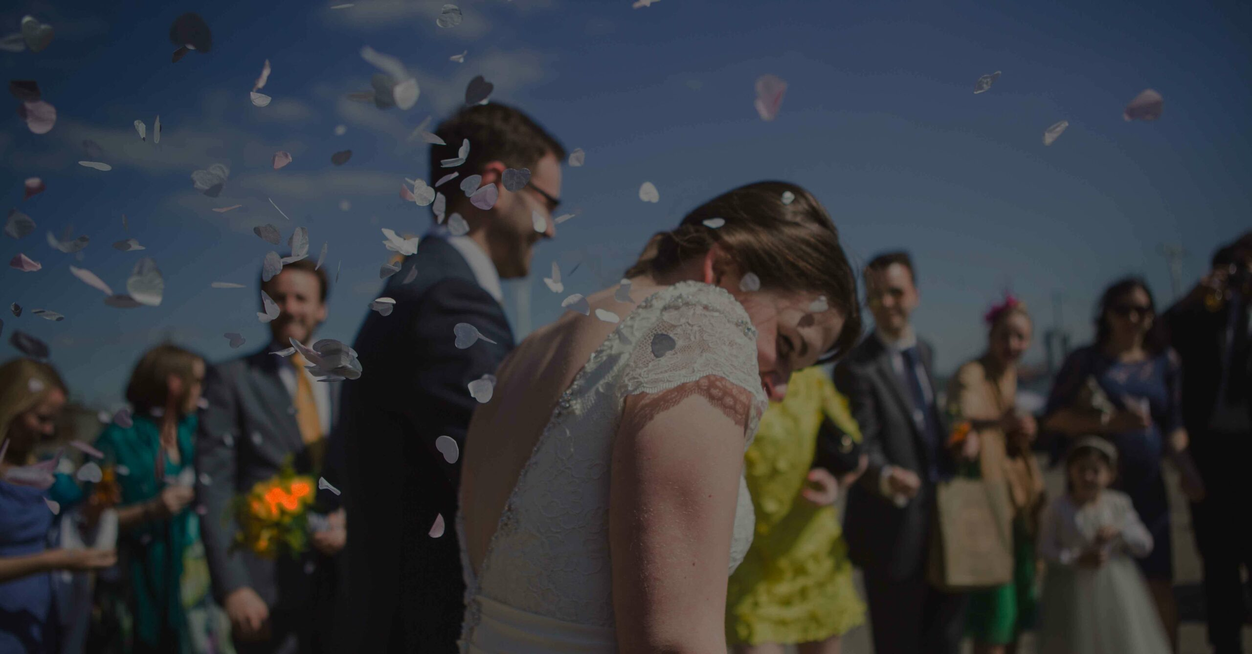 Wedding couple out of focus walking through confetti